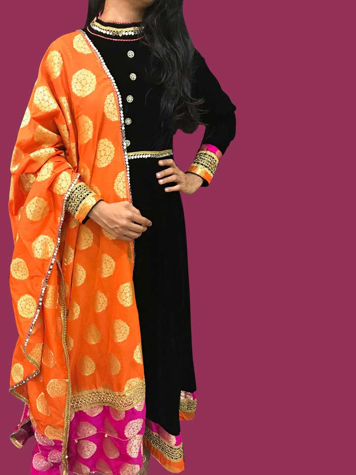 A Velvet Dress in the Aristocratic Black with a Classy Combo of Orange and Pink Benaras Dupatta in Pure Silk