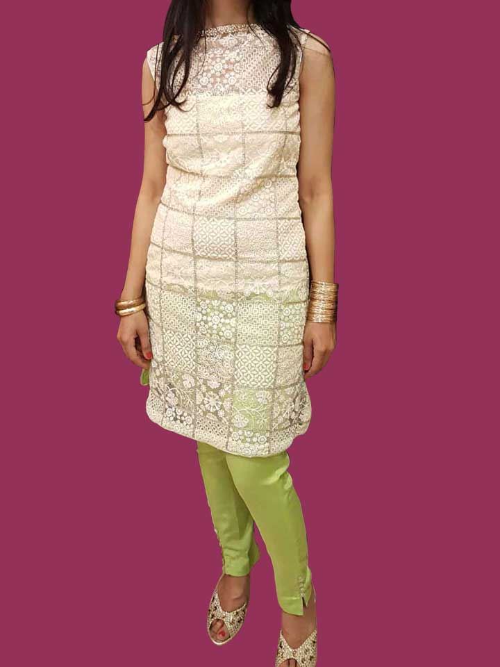An Embroidered Kurti in Silver Sequence with a Boat Neck in Pearls and Kundans paired up with Taipei Silk Straight Pants