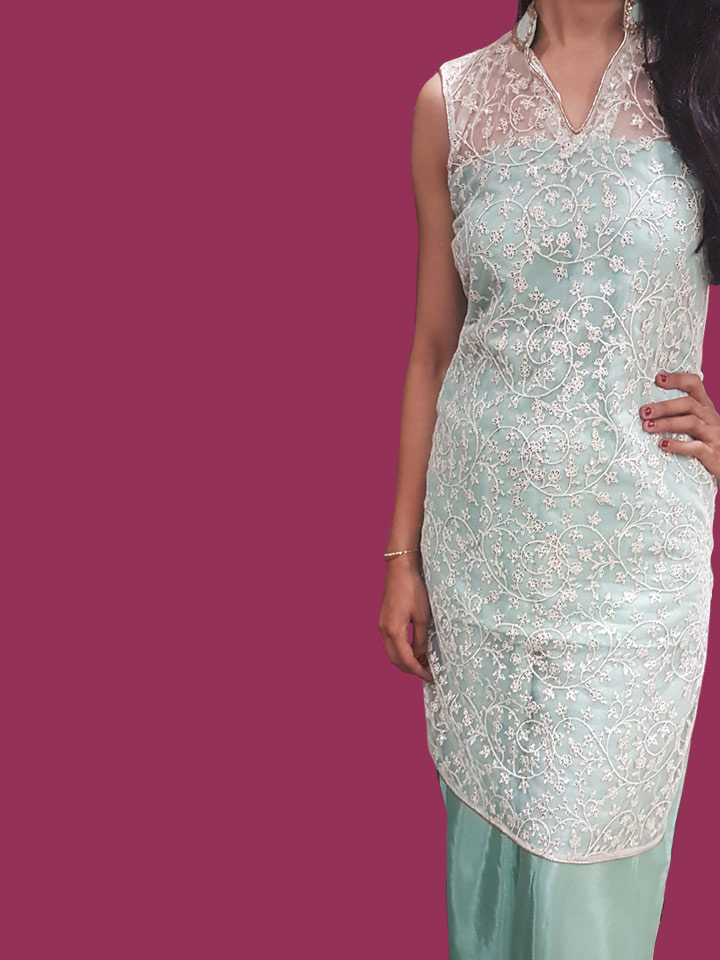 An Embroidered Net Kurti with Kundans Neck Line paired up with a Sea Blue Taipei Silk Palazzo